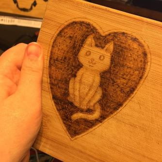 My first attempt at pyrography (on an old cutting board)